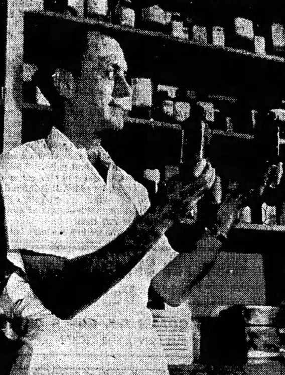 Pharmacist Paul Benecke holding a bottle of Thorazine and an herbal extract, Rauwolfia at Alton State Hospital.