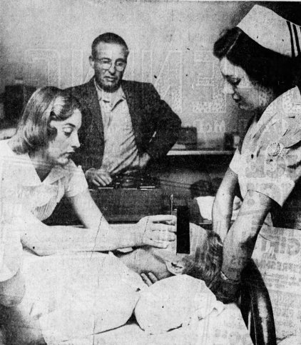 Dr. Carl Breitner of Arizona State Hospital administers non-convulsive electric shock therapy to a patient.