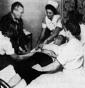 Dr. Carl Breitner injects anesthetic to put patient to sleep before non-convulsive therapy.