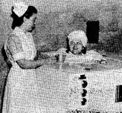 A student nurse receiving a heat treatment at Massillon State Hospital.